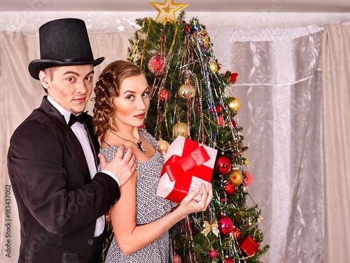 Couple On Party Near Christmas Tree Take Gift Box And Xmas Presents Happy Family