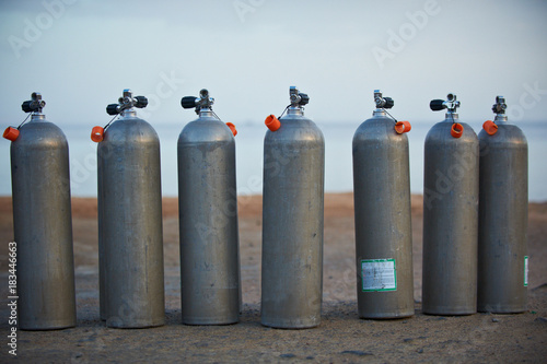 Photo Collection of grey scuba diving air oxygen tanks.