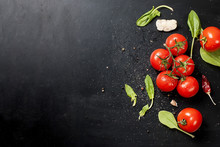 Black Rustic Tabletop With Branch Of Tomatoes And Herbs, Top View