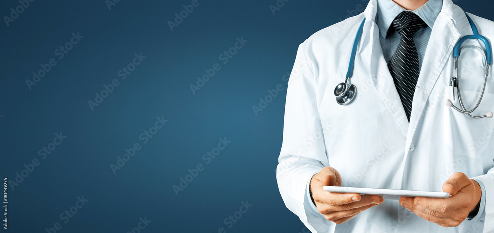 Fototapety, obrazy: Doctor using digital tablet, modern technology in medicine and healthcare concept on blue background