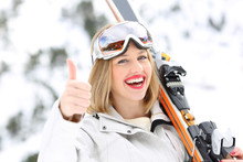 Happy Skier With Thumbs Up In A Slope