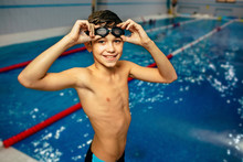 Young Boy Wearing Swimming Gog...