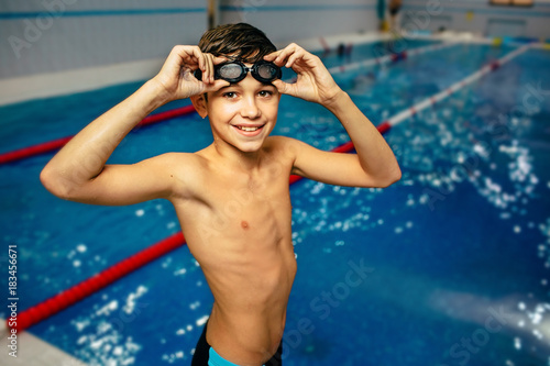 young boy wearing swimming goggles