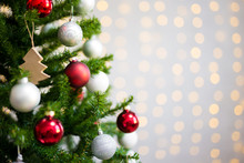 Christmas And New Year Background - Decorated Christmas Tree Over White Wall With Lights