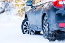 Winter Tires. Black Subaru Out...
