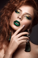Beautiful Redhair Model: Curls, Bright Makeup, Jewelry And Green Lips. The Beauty Face.
