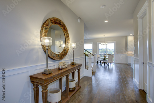Fabulous foyer features a wood console table Canvas-taulu