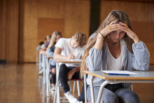 Anxious Teenage Student Sittin...