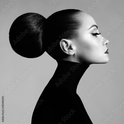 Obraz Beautiful elegant woman in black turtleneck - fototapety do salonu