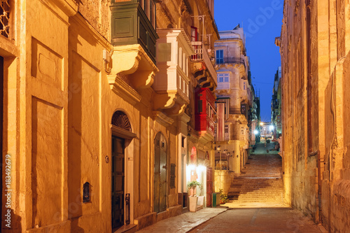 typical-maltese-medieval-street-at-night-in-the-center-of-the-old-town-of-valletta-malta