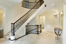 Foyer With Wrought Iron Stairc...