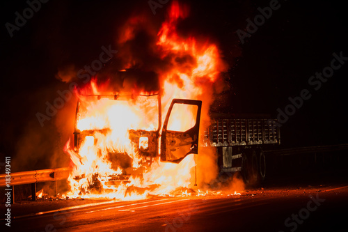 Burning truck on the highway Poster Mural XXL