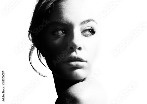 obraz dibond High contrast black and white portrait of a beautiful girl.