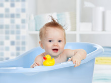 Cute Baby Having Bath In Blue ...