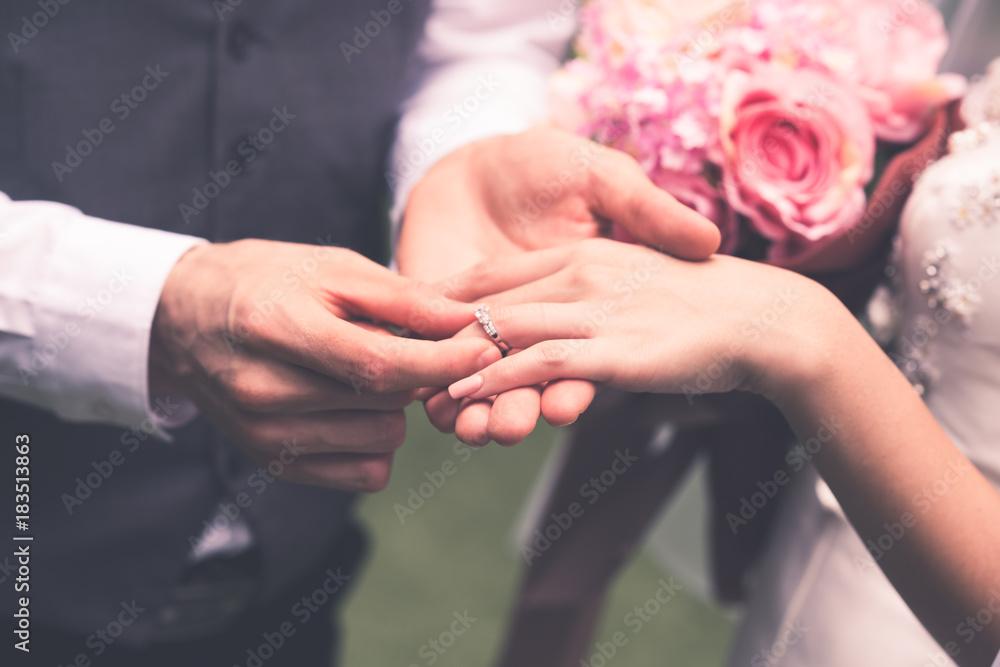 Fototapety, obrazy: Groom wears the bride's ring.