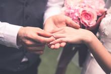 Groom Wears The Bride's Ring.