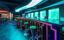 Bar Counter And Stools In Modern Discotheque Interior