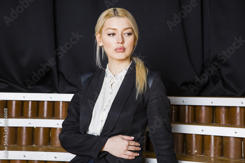 Fotomural Beautiful blonde businesswoman with puffy lips at loft office in suit