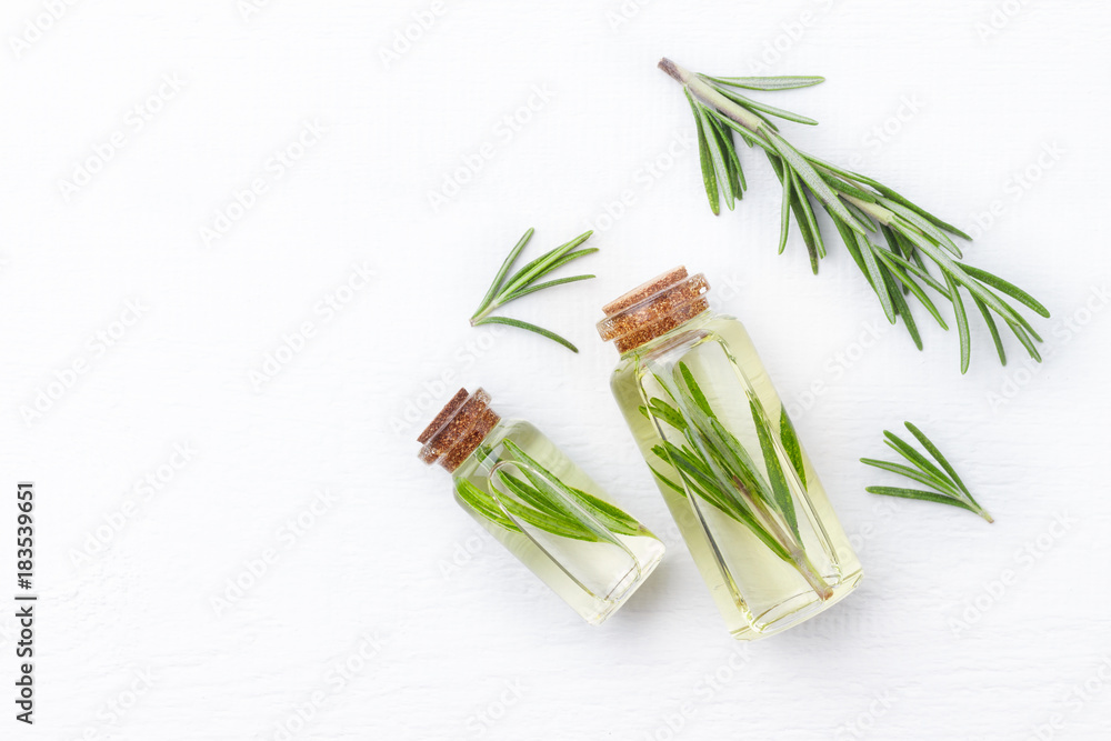 Fototapety, obrazy: Organic cosmetics with extracts of herbs rosemary on white wooden background.