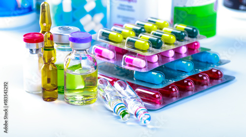 Spoed Foto op Canvas Apotheek Drug prescription for treatment medication. Pharmaceutical medicament, cure in container for health. Pharmacy theme, capsule pills with medicine antibiotic in packages.