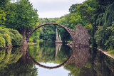 Fototapeta Natura - Rakotz bridge (Rakotzbrucke) also known as Devil's Bridge in Kromlau, Germany. Reflection of the bridge in the water create a full circle.