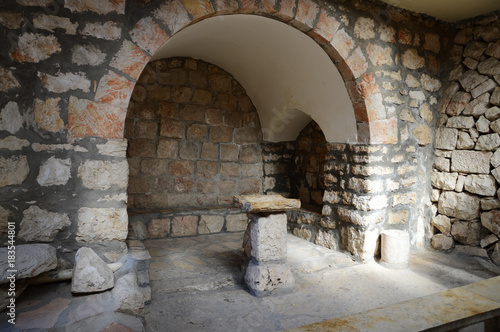 Ancient stone chair for preaching in the church