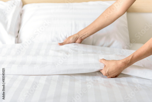 Hand set up white bed sheet in room Canvas Print