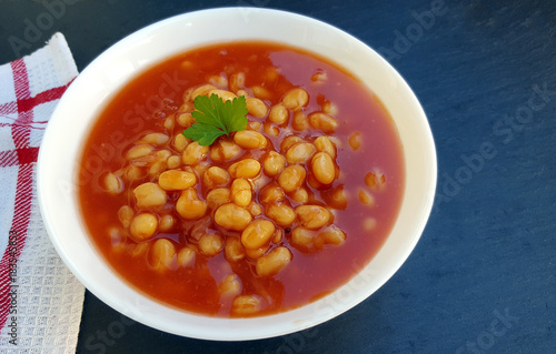 Photo  Baked beans in tomato sauce on plate
