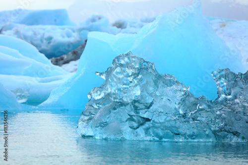 Deurstickers Antarctica Little blue iceberg floating on the sea