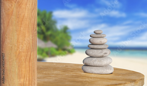 Acrylic Prints Stones in Sand Zen stone like symbol of health and harmony with beach background