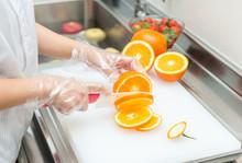 Female Hands Cutting Fresh Jui...