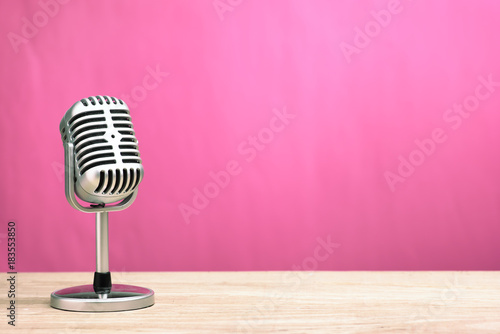 Retro microphone on wooden table with pink wall background Canvas Print