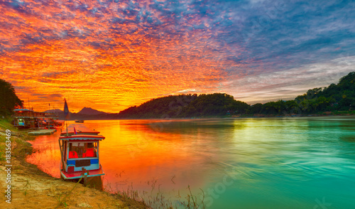 Cadres-photo bureau Riviere Touristic boat at sunset. Beautiful landscape. Luang Prabang. Laos.