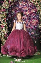 Girl In A Purple Dress On A Fl...