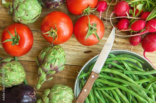 Fresh Organic Vegetables Artichokes Green Beans Tomatoes Red Radish Broccoli Eggplants on Weathered Wood Garden Kitchen