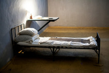 Dark Prison Cell With Bed At N...