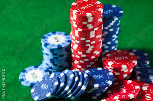 poker chips stack on green table плакат