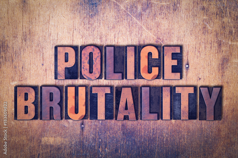 Police Brutality Theme Letterpress Word on Wood Background