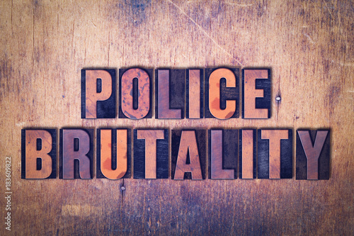 Photo  Police Brutality Theme Letterpress Word on Wood Background