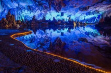 Colorful Reflection Inside Reed Flute Cave In China