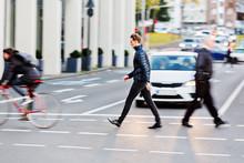 Man Crosses A City Street