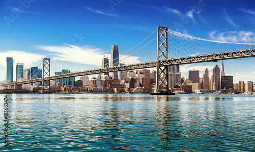 Photo Downtown San Francisco and Oakland Bay Bridge on sunny day