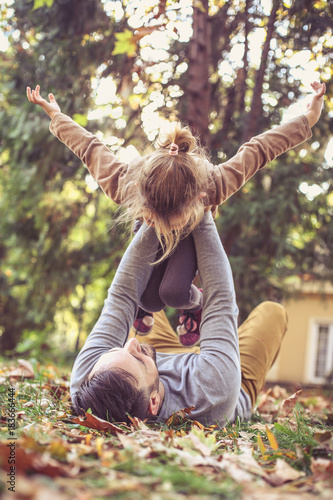 Fotografie, Obraz  Little girl playing with Dad.