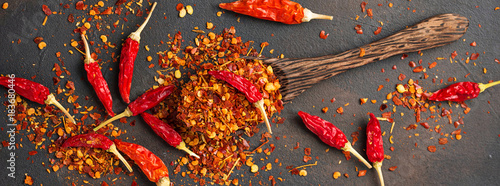 Photo Stands Hot chili peppers Red hot chili peppers on rusty background