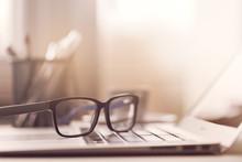 Eyeglasses On Laptop In Sunlight