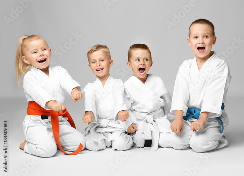 Poster Martial arts Little children in karategi on light background