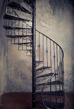 Metal Spiral Staircase Against...
