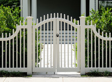 White Wooden Gate And Picket Fence On Elegant Home Entrance