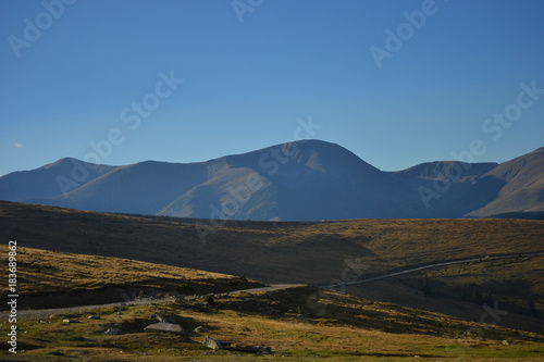 Fotografie, Obraz  Alpine mountain landscape summer and autumn view in a sunny day with a blue sky