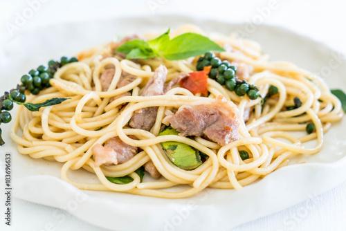 stir-fried spicy spaghetti with pork - Buy this stock photo